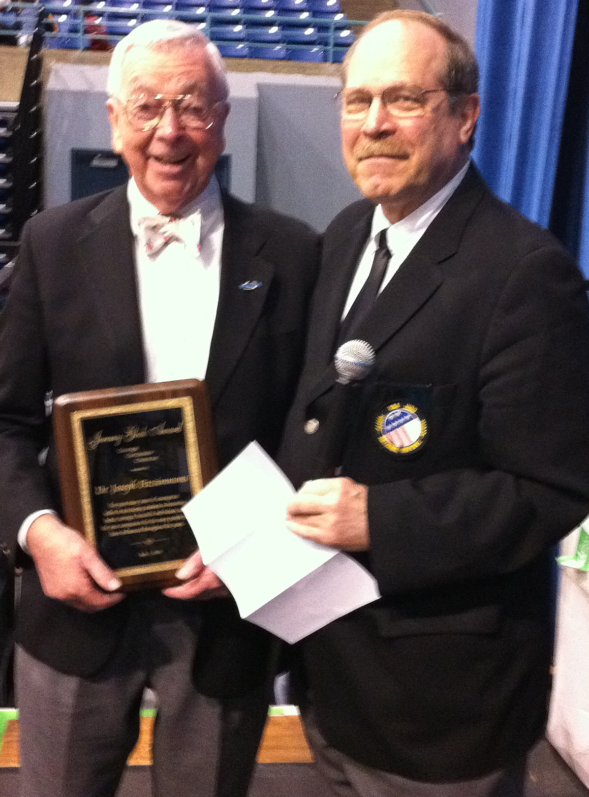 Dr. Fitzimmons receiving award from Neil Simon