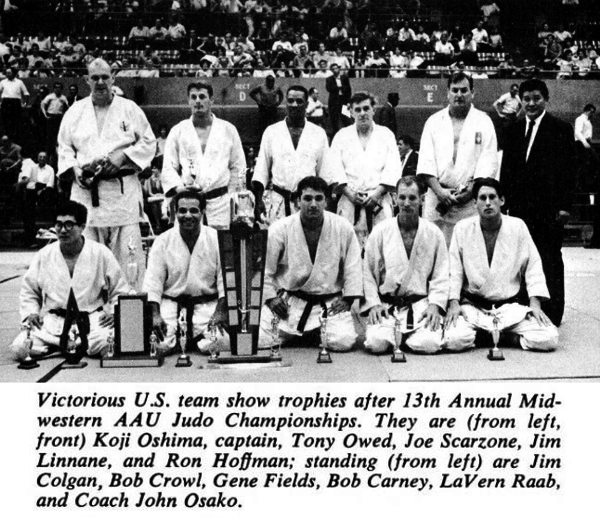 Victorious US team show tropies after 13th Annual Midwstern AAU Judo Championships. They are (from left, front) Koji Oshima, captain, Tony Owed, Joe Scarzone, Jim Linnane, and Ron Hoffman; standing (from left) are Jim Golgan, Bob Crowl, Gene Fields, Bob Carney, Lavern Raab, and Coach John Osako.