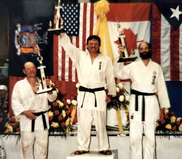 John earned a gold medal in the Am–Can Challenge in 1990–1991