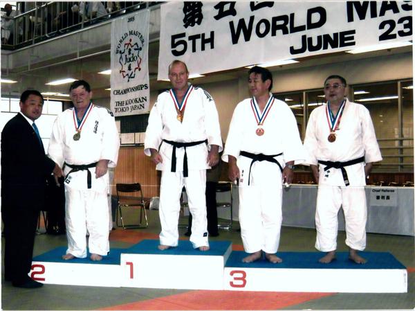 Japanese Judo great, Yasuhiro Yamashita, congratulates John Bassano, Sr. for earning a silver medal at the Fifth World Masters Judo Championship in 2003.