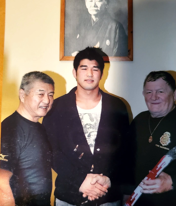 John with Sensei Shiina and Kasei Inove (2000 Summer Olympoc Gold medalist) as he received his Shichidan, 7th degree black belt, at the age of 70
